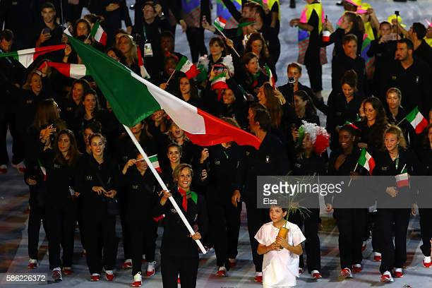 Flag bearer Federica Pellegrini of Italy leads her team during the Opening Ceremony of the Rio 2016 Olympic Games at Maracana Stadium on August 5...