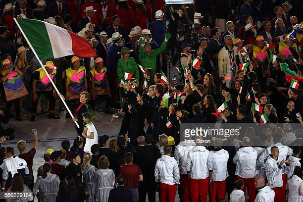 Flag bearer Federica Pellegrini of Italy leads the team entering the stadium during the Opening Ceremony of the Rio 2016 Olympic Games at Maracana...