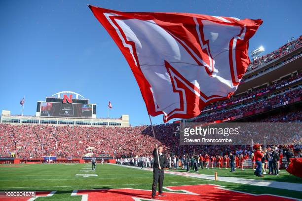 A flag bearer for the Nebraska Cornhuskers waves the flag after a touchdown against the Bethune Cookman Wildcats at Memorial Stadium on October 27...