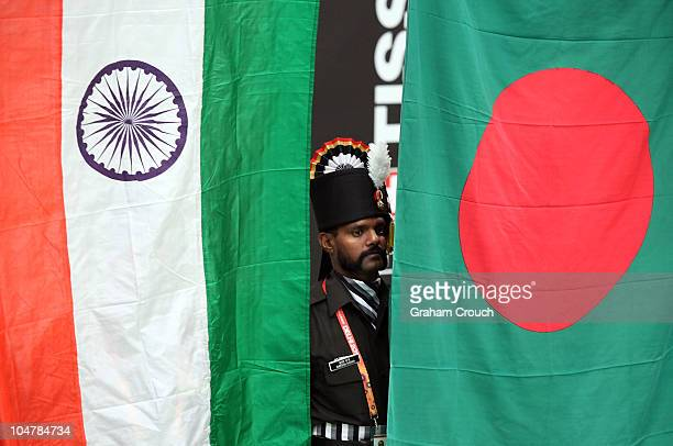 A flag bearer from 335 Infantry of the Indian Army watches the Indian and Bangladesh flags being raised during a medal ceremony at the at Dr Karni...