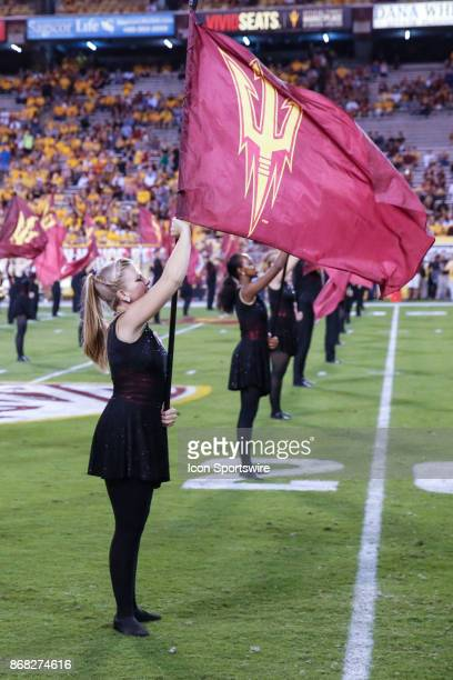A flag bearer holds the Sun Devil Flag before the college football game between the USC Trojans and the Arizona State Sun Devils on October 28 2017...