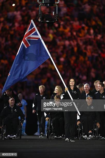 Flag bearer Holly Robinson of New Zealand leads the team entering the stadium during the Opening Ceremony of the Rio 2016 Paralympic Games at...
