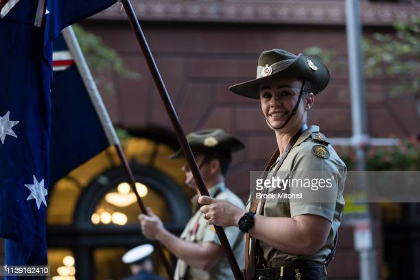 A flag bearer is pictured before the ANZAC Day March on April 25 2019 in Sydney Australia Australians commemorating 104 years since the Australian...