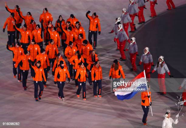 Flag bearer Jan Smeekens of the Netherlands enters the stadium with teammmates during the Opening Ceremony of the PyeongChang 2018 Winter Olympic...