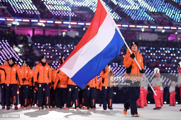 Flag bearer Jan Smeekens of the Netherlands leads his country out during the Opening Ceremony of the PyeongChang 2018 Winter Olympic Games at...