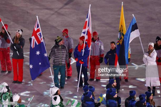 Flag bearer Jarryd Hughes of Australia and flag bearer Billy Morgan of Great Britain participate in the Parade of Athletes during the Closing...