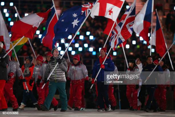 Flag bearer Jarryd Hughes of Australia walks in the Parade of Athletes during the Closing Ceremony of the PyeongChang 2018 Winter Olympic Games at...