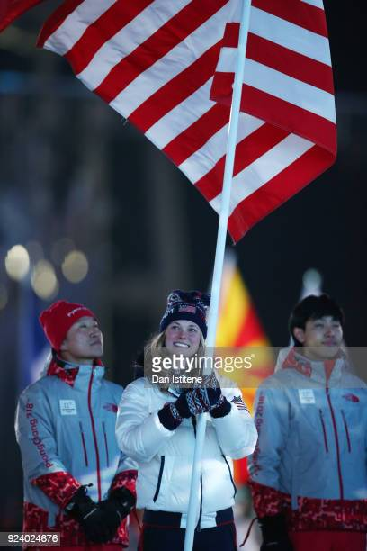 Flag bearer Jessica Diggins of the United States participates in the Parade of Athletes during the Closing Ceremony of the PyeongChang 2018 Winter...