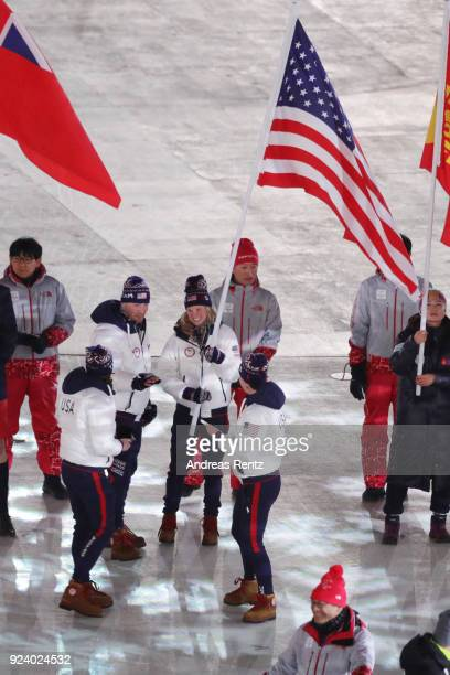 Flag bearer Jessica Diggins of the United States walks in the Parade of Athletes during the Closing Ceremony of the PyeongChang 2018 Winter Olympic...