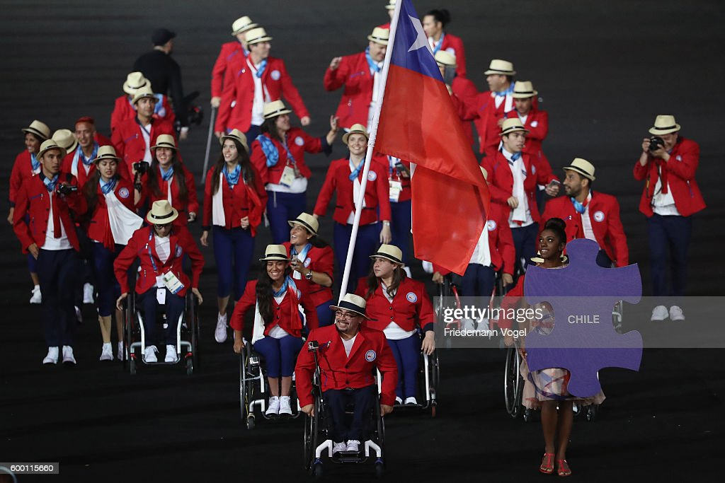Flag bearer Juan Carlos Garrido of Chile leads the team entering the