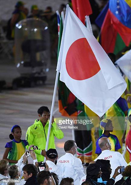 Flag bearer Keisuke Ushiro of Japan walks during the 'Heroes of the Games' segment during the Closing Ceremony on Day 16 of the Rio 2016 Olympic...