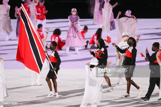 Flag bearer Kelly-Ann Baptiste of Team Trinidad and Tobago leads the team out during the Opening Ceremony of the Tokyo 2020 Olympic Games at Olympic...
