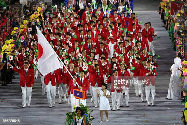 Flag bearer Kiesuke Ushiro of Japan leads his team during the Opening Ceremony of the Rio 2016 Olympic Games at Maracana Stadium on August 5, 2016 in...