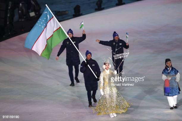 Flag bearer Komiljon Tukhtaev of Uzbekistan during the Opening Ceremony of the PyeongChang 2018 Winter Olympic Games at PyeongChang Olympic Stadium...