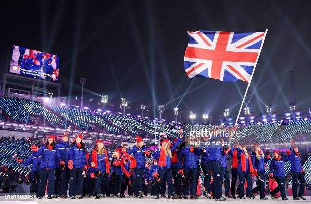 Flag bearer Lizzy Yarnold of Great Britain and teammates enter the stadum during the Opening Ceremony of the PyeongChang 2018 Winter Olympic Games at...