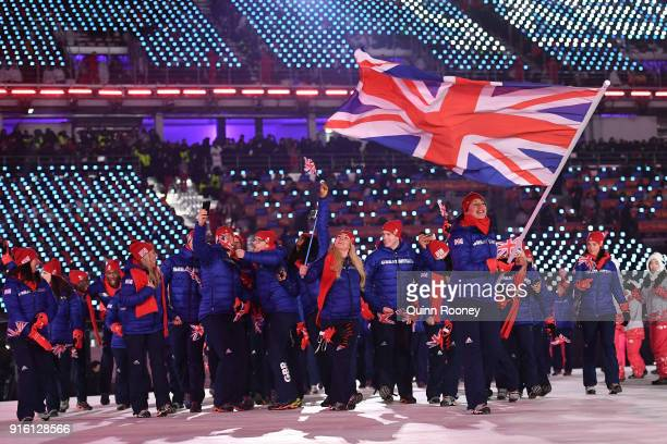 Flag bearer Lizzy Yarnold of Great Britain leads her country out during the Opening Ceremony of the PyeongChang 2018 Winter Olympic Games at...
