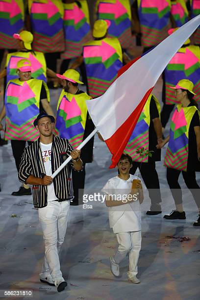 Flag bearer Lukas Krpalek of the Czech Republic leads his Olympic team during the Opening Ceremony of the Rio 2016 Olympic Games at Maracana Stadium...