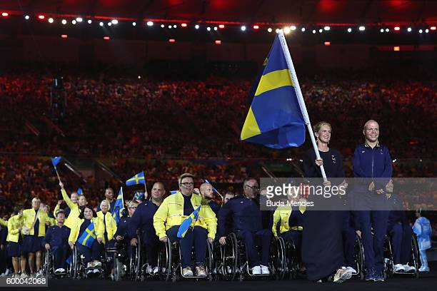 Flag bearer Maja Reichard of Sweden leads the team entering the stadium during the Opening Ceremony of the Rio 2016 Paralympic Games at Maracana...