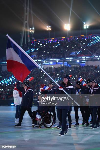 Flag bearer Marie Bochet of France leads the team during the opening ceremony of the PyeongChang 2018 Paralympic Games at the PyeongChang Olympic...