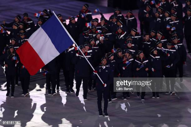 Flag bearer Martin Fourcade of France leads in his country during the Opening Ceremony of the PyeongChang 2018 Winter Olympic Games at PyeongChang...