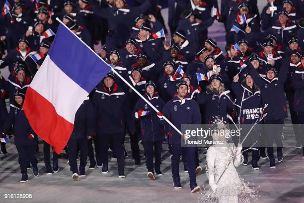 Flag bearer Martin Fourcade of France leads the team during the Opening Ceremony of the PyeongChang 2018 Winter Olympic Games at PyeongChang Olympic...