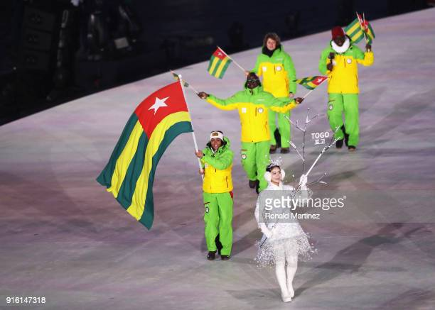 Flag bearer MathildeAmivi Petitjean of Togo leads the team during the Opening Ceremony of the PyeongChang 2018 Winter Olympic Games at PyeongChang...