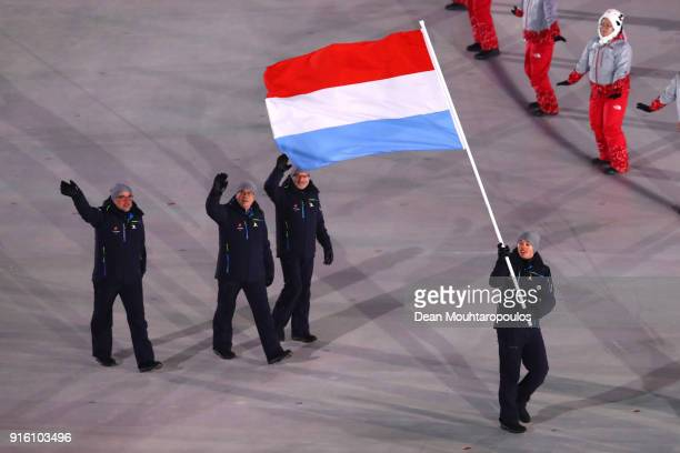 Flag bearer Mattheiu Osch of Luxembourg and teammates enter the stadium during the Opening Ceremony of the PyeongChang 2018 Winter Olympic Games at...