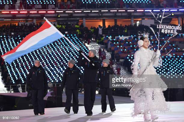 Flag bearer Mattheiu Osch of Luxembourg leads his country during the Opening Ceremony of the PyeongChang 2018 Winter Olympic Games at PyeongChang...