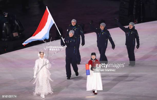 Flag bearer Mattheiu Osch of Luxembourg leads the team during the Opening Ceremony of the PyeongChang 2018 Winter Olympic Games at PyeongChang...