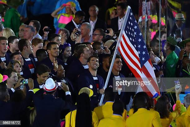 Flag bearer Michael Phelps of the United States leads his team during the Opening Ceremony of the Rio 2016 Olympic Games at Maracana Stadium on...