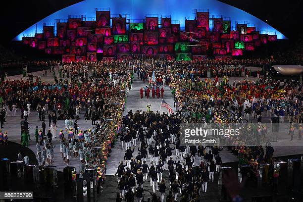 Flag bearer Michael Phelps of the United States leads out his country during the Opening Ceremony of the Rio 2016 Olympic Games at Maracana Stadium...