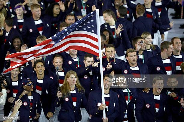 Flag bearer Michael Phelps of the United States leads the US Olympic Team during the Opening Ceremony of the Rio 2016 Olympic Games at Maracana...