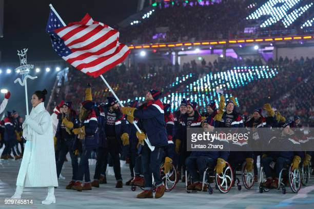 Flag bearer Mike schultz of the United States of America leads the team during the opening ceremony of the PyeongChang 2018 Paralympic Games at the...