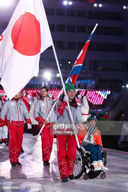 Flag bearer Momoka Muraoka of Japan attend the closing ceremony of the PyeongChang 2018 Paralympic Games at the PyeongChang Olympic Stadium on March...