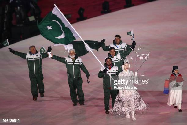Flag bearer Muhammad Karim of Pakistan leads the team during the Opening Ceremony of the PyeongChang 2018 Winter Olympic Games at PyeongChang Olympic...