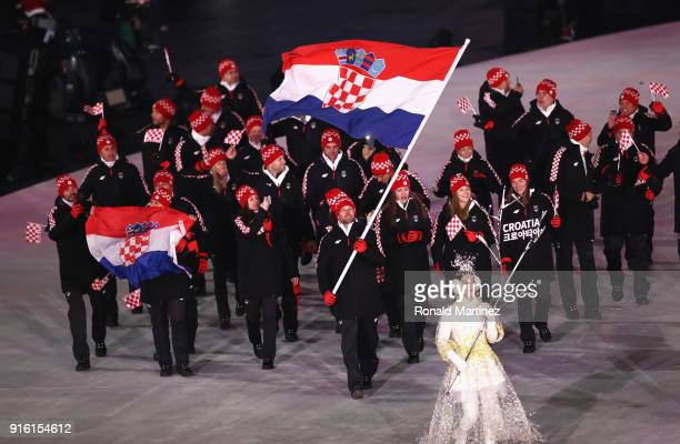 Flag bearer Natko ZrncicDim of Croatia leads the team during the Opening Ceremony of the PyeongChang 2018 Winter Olympic Games at PyeongChang Olympic...