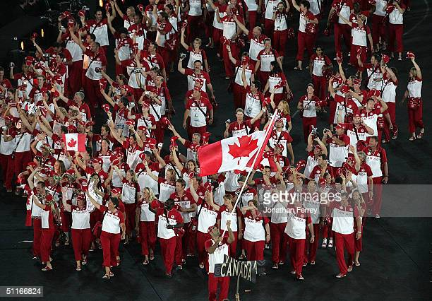 Flag bearer Nicolas Gill leads team Canada during opening ceremonies for the Athens 2004 Summer Olympic Games on August 13 2004 at the Sports Complex...