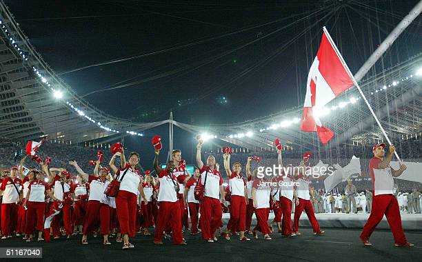 Flag bearer Nicolas Gill leads the delegation from Canada as they walk during the parade of nations part of the opening ceremonies for the Athens...