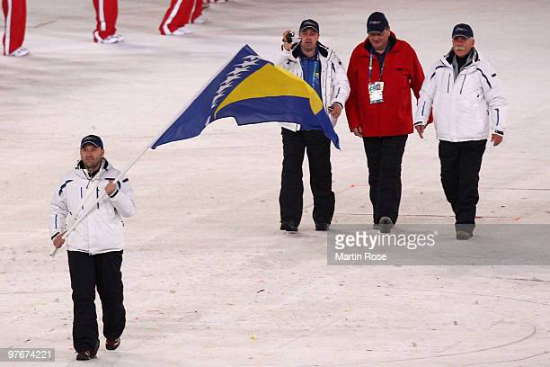Flag bearer Nijaz Memic of Bosnia and Herzegovina leads his team through the stadium during the Opening Ceremony of the 2010 Vancouver Winter...