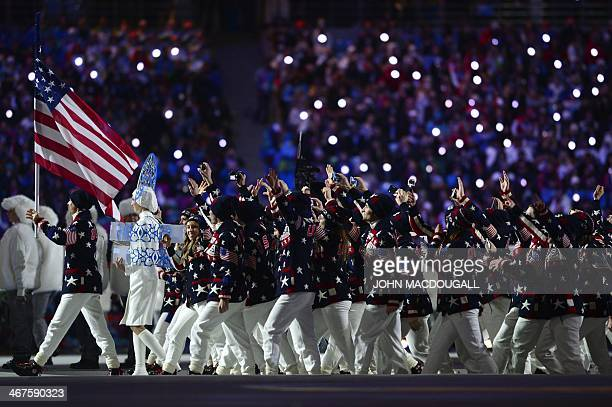 US flag bearer nordic combined skier Todd Lodwick leads his national delegation during the Opening Ceremony of the 2014 Sochi Winter Olympics at the...