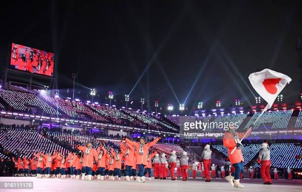 Flag bearer Noriaki Kasai of Japan and teammates enter the stadium during the Opening Ceremony of the PyeongChang 2018 Winter Olympic Games at...