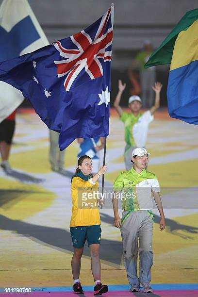 Flag bearer of Australia holds the national flag during the closing ceremony for the Nanjing 2014 Summer Youth Olympic Games at the Nanjing Olympic...