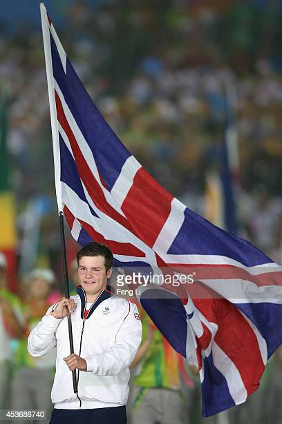 Flag bearer of the United Kingdom holds the national flag during the opening ceremony for the Nanjing 2014 Summer Youth Olympic Games at the Nanjing...
