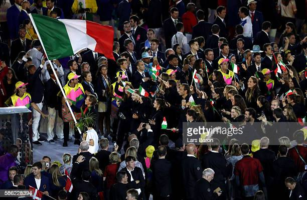 Flag bearer Pederica Pellegrini of Italy leads the team entering the stadium during the Opening Ceremony of the Rio 2016 Olympic Games at Maracana...