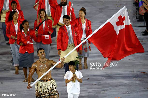 Flag bearer Pita Nikolas Aufatofua of Tonga leads his Olympic Team during the Opening Ceremony of the Rio 2016 Olympic Games at Maracana Stadium on...