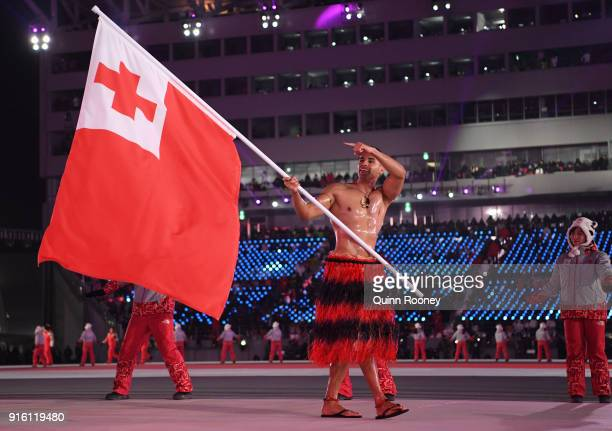 Flag bearer Pita Taufatofua of Tonga leads his country out during the Opening Ceremony of the PyeongChang 2018 Winter Olympic Games at PyeongChang...