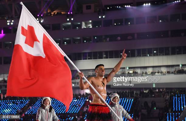 Flag bearer Pita Taufatofua of Tonga leads out his country during the Opening Ceremony of the PyeongChang 2018 Winter Olympic Games at PyeongChang...