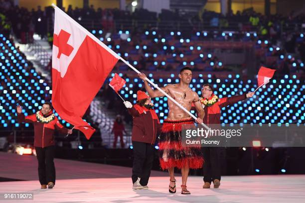 Flag bearer Pita Taufatofua of Tonga leads the team during the Opening Ceremony of the PyeongChang 2018 Winter Olympic Games at PyeongChang Olympic...