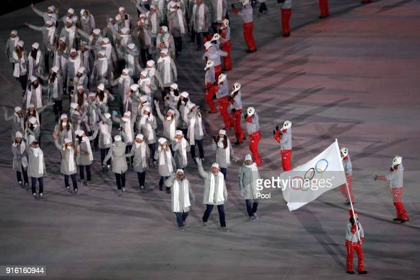 Flag bearer POCPG Volunteer of Olympic Athletes from Russia and teammatea arrive during the Opening Ceremony of the PyeongChang 2018 Winter Olympic...