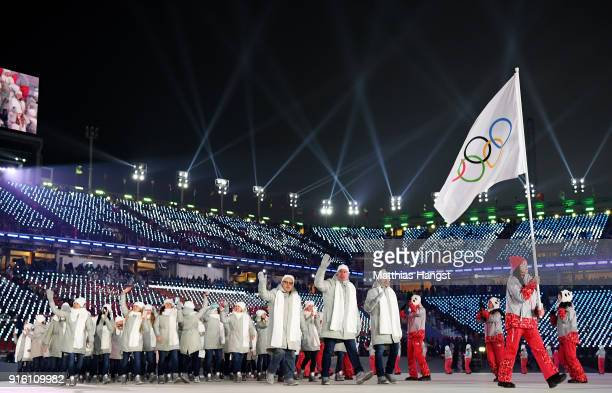 Flag bearer POCPG Volunteer of Olympic Athletes from Russia and teammates enter the stadium during the Opening Ceremony of the PyeongChang 2018...